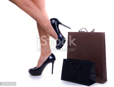 istock Woman legs with shopping bags 531504525