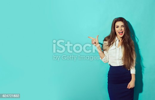 istock woman let eyelet and pointing with finger to the left 624721832