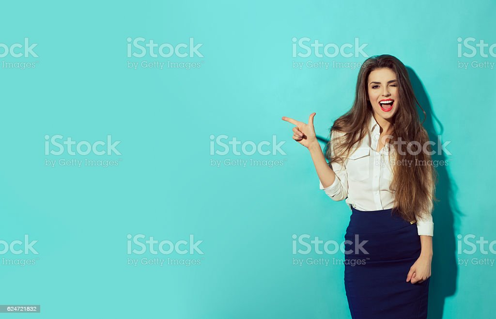 woman let eyelet and pointing with finger to the left stock photo