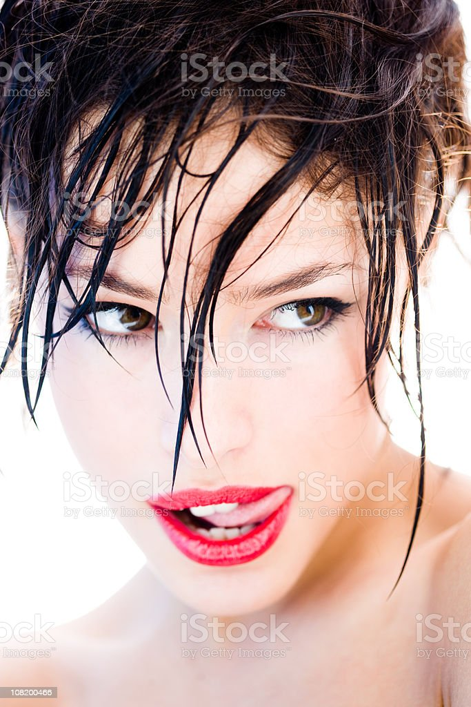 Woman Licking Lips with Wet Hair stock photo