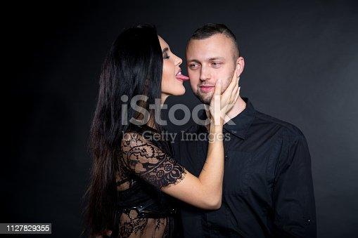 istock Woman Licks boss by long tongue licking 1127829355