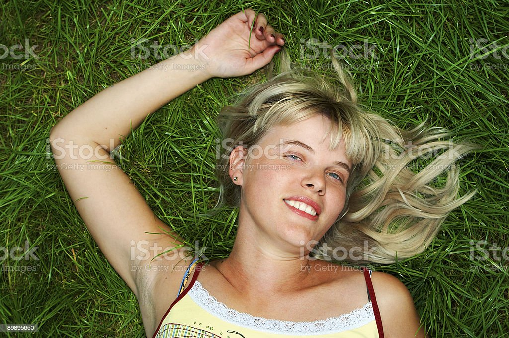 woman lie on grass royalty-free stock photo