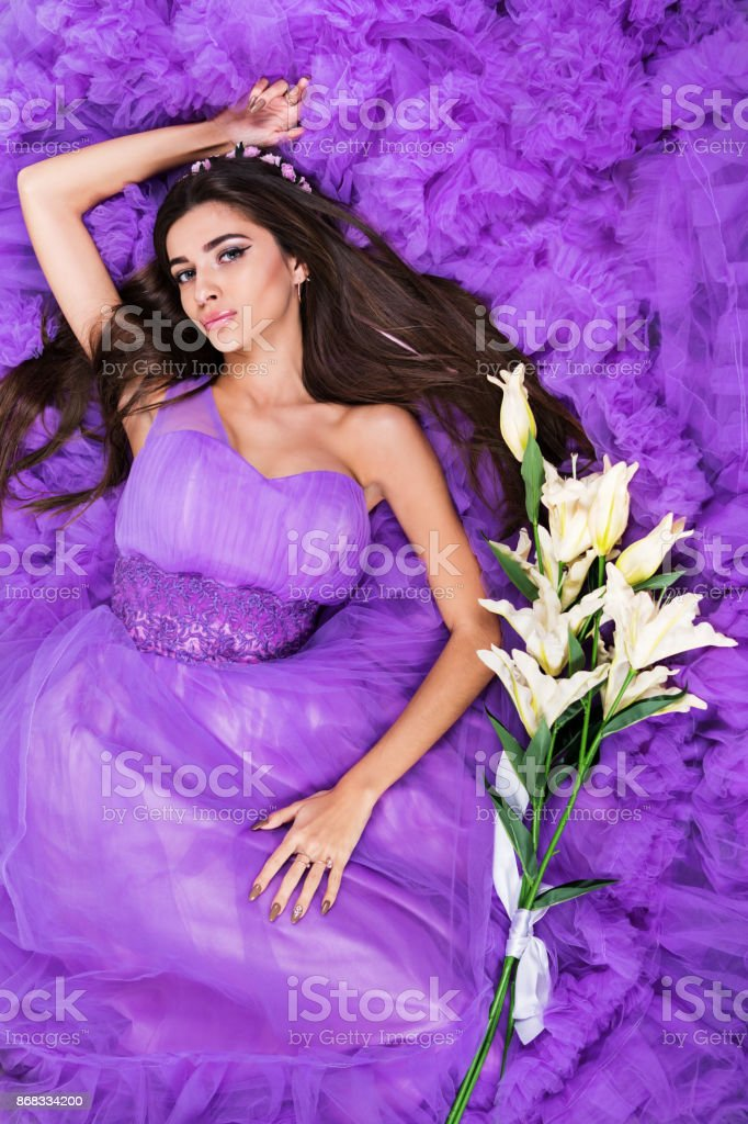 Woman lies on hem of her dress stock photo
