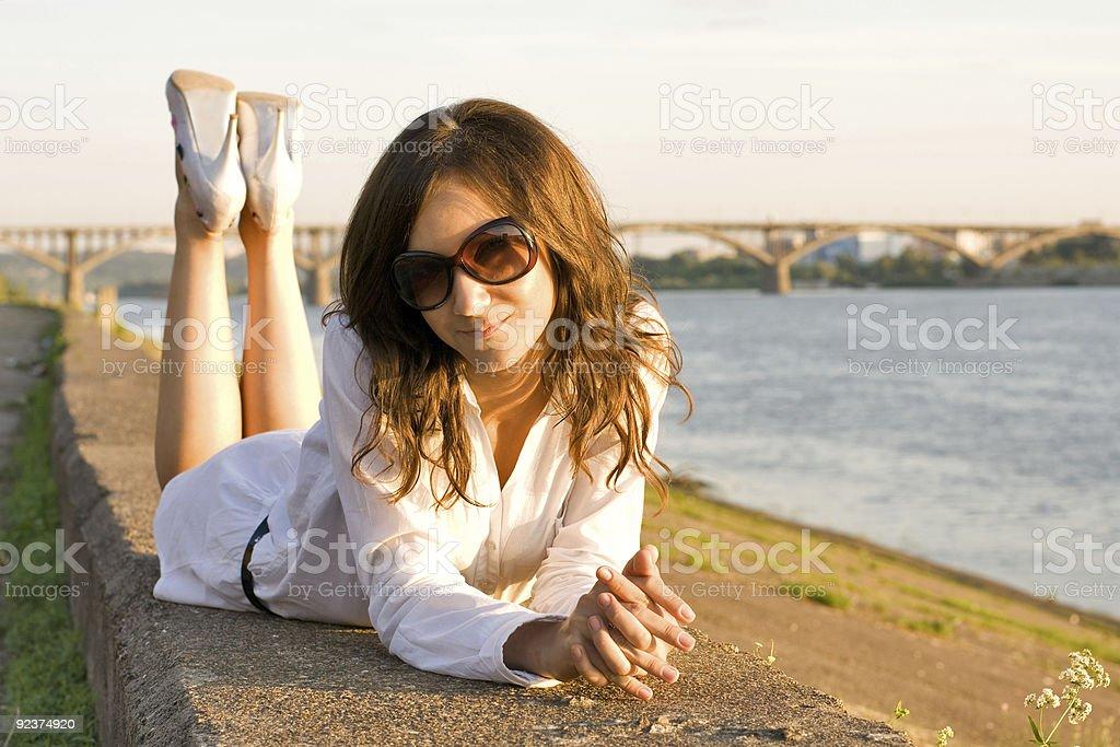 Woman lies on parapet royalty-free stock photo