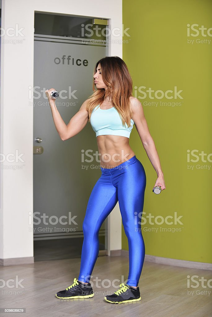 woman lifting a dumb-bell stock photo