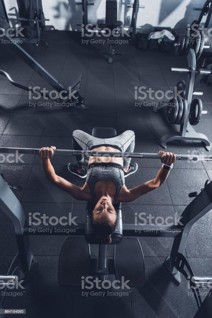 woman lifting barbell royalty-free stock photo