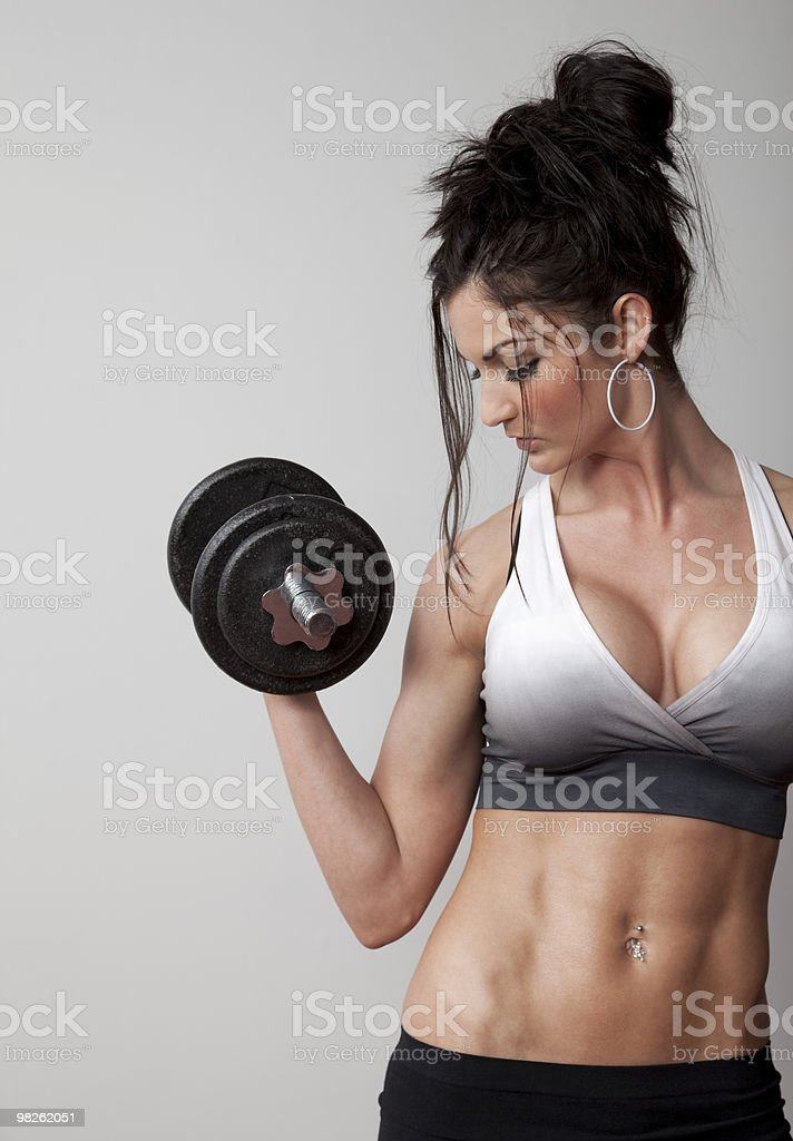 Woman Lifting Dumbbell royalty-free stock photo