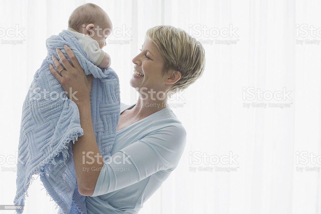 Woman lifting newborn baby royalty-free stock photo