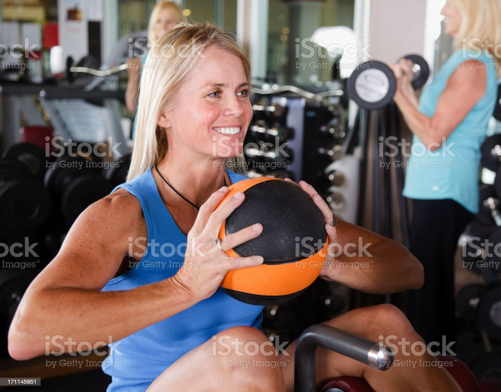 Woman Lifting Weight in Gym royalty-free stock photo