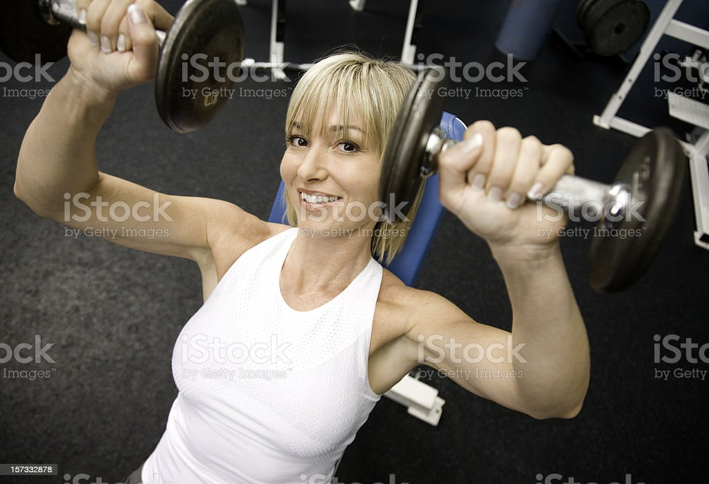 Woman Lifting Weights royalty-free stock photo