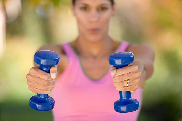 Woman lifting weights stock photo