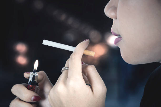 https://media.istockphoto.com/photos/woman-lighting-cigarette-picture-id682559702?k=6&m=682559702&s=612x612&w=0&h=IlD4EiX2UUOeO-HKSQGWRzZIc609O5NOspqeTMb2C68=
