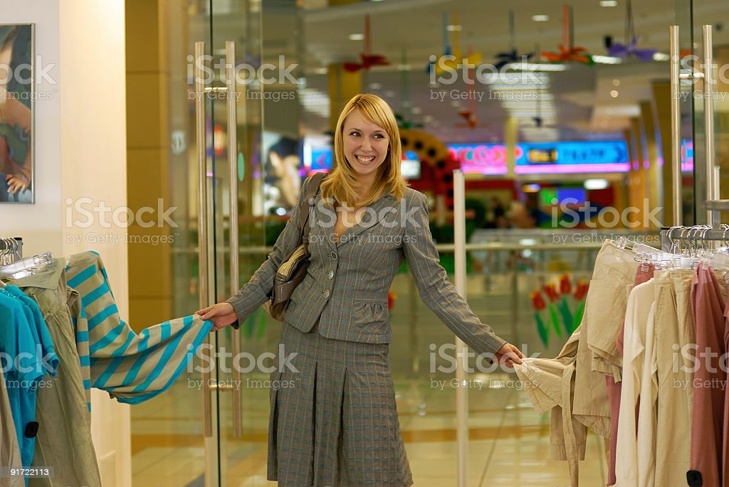 Woman likes both blouses! royalty-free stock photo