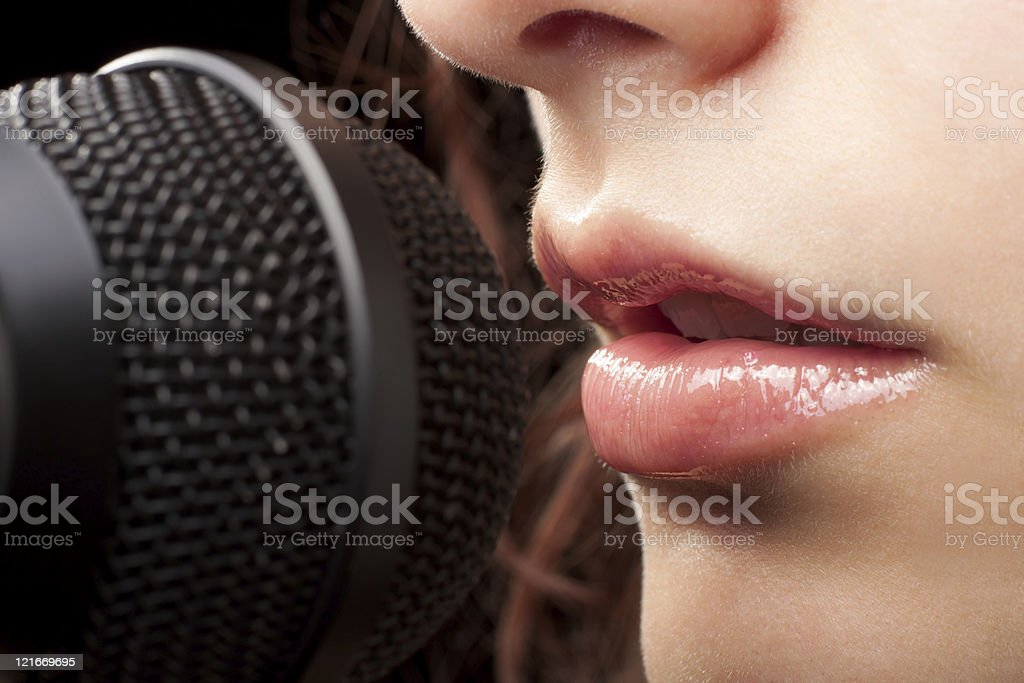 Woman Lips and Microphone stock photo