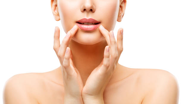 Woman Lips Care and Face Beauty Make Up, Model Touching Lip by Hands, Natural Skin Makeup stock photo