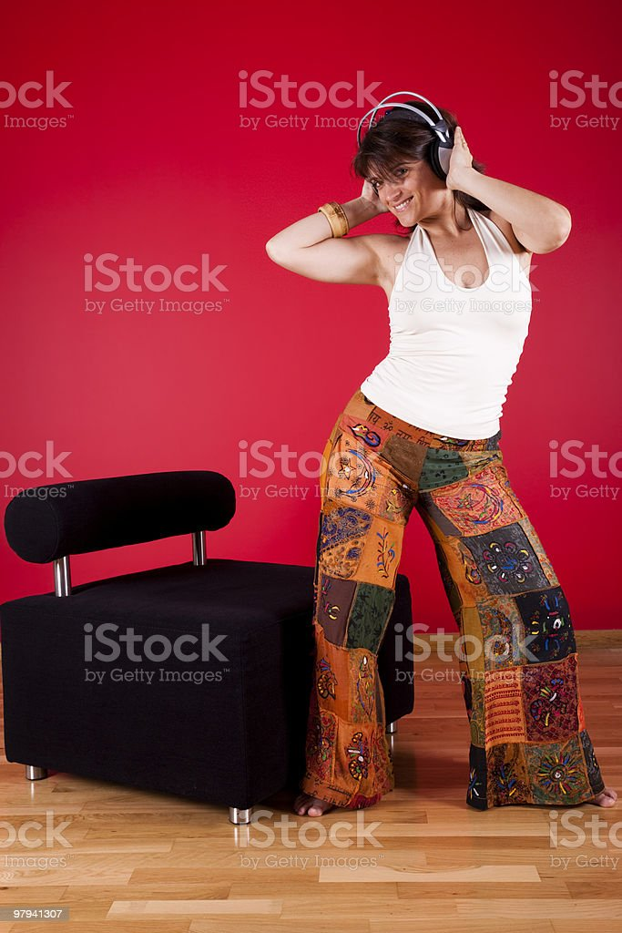 Woman listen music at her house royalty-free stock photo