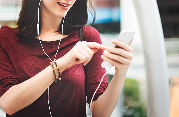Woman Listening Music Media Entertainment Walking Concept stock photo