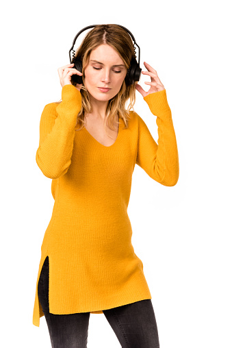 woman listening the music with headphone
