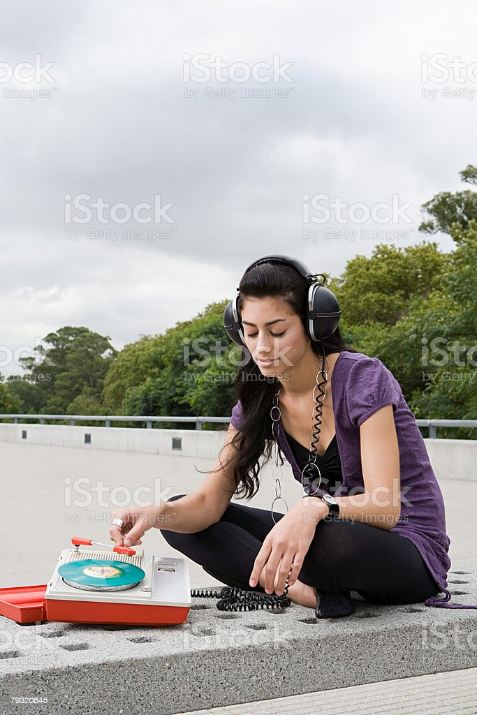 Woman listening to a record outside royalty-free 스톡 사진
