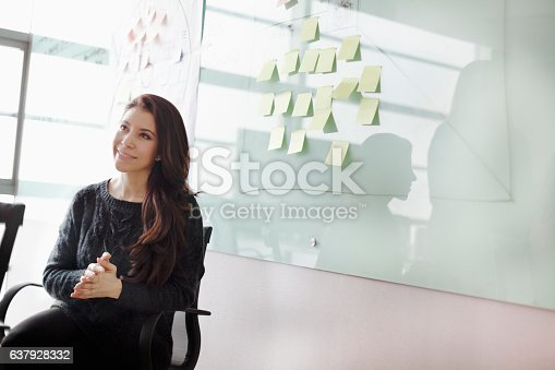 istock Woman listening to colleagues in studio office 637928332