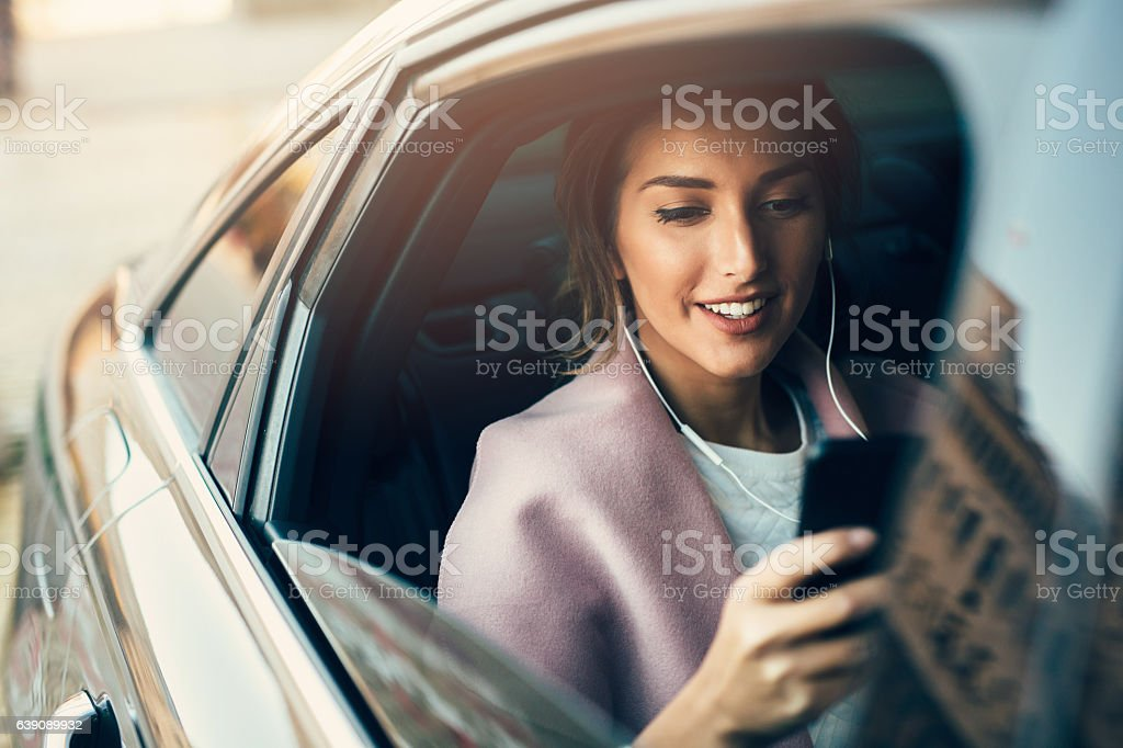 Woman listening to music in a car stock photo