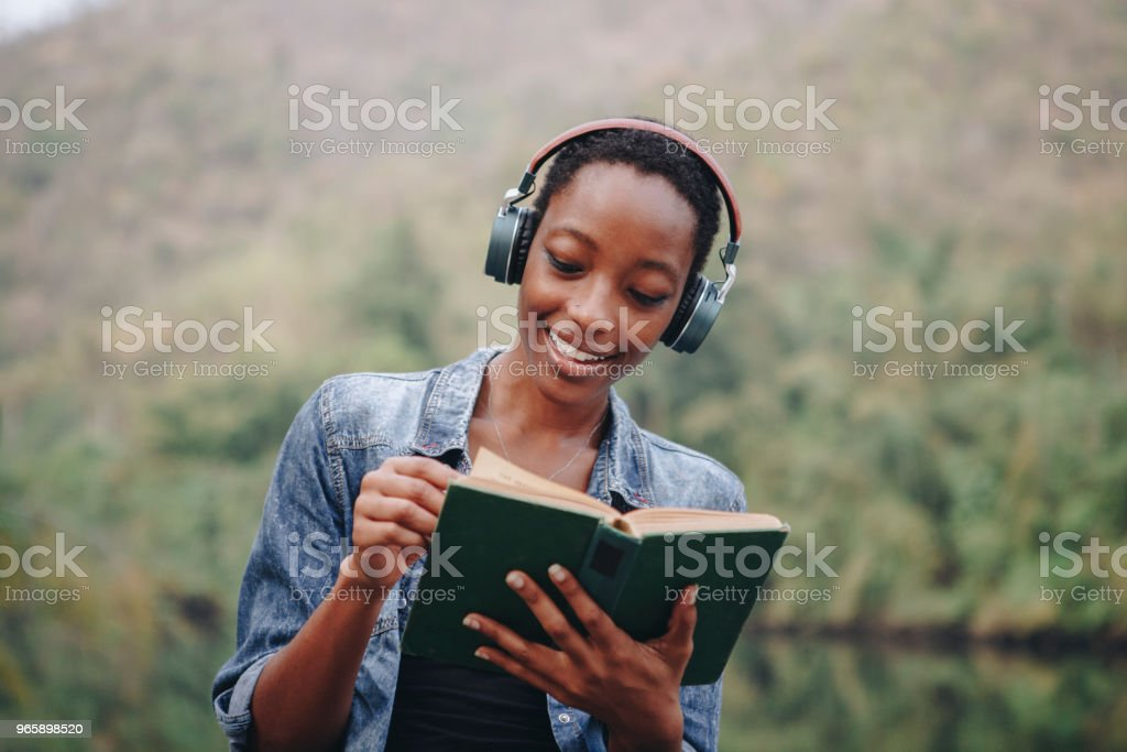 Woman listening to music in nature stock photo