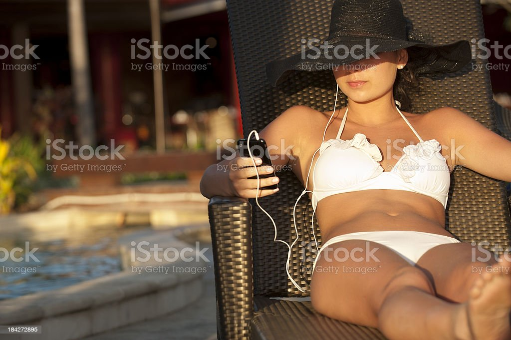 Woman listening to music on a smartphone royalty-free stock photo