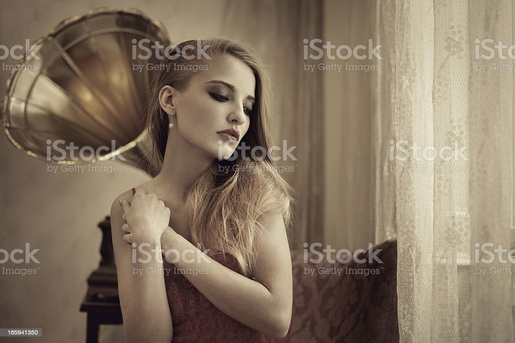 woman listening to music on gramophone royalty-free stock photo