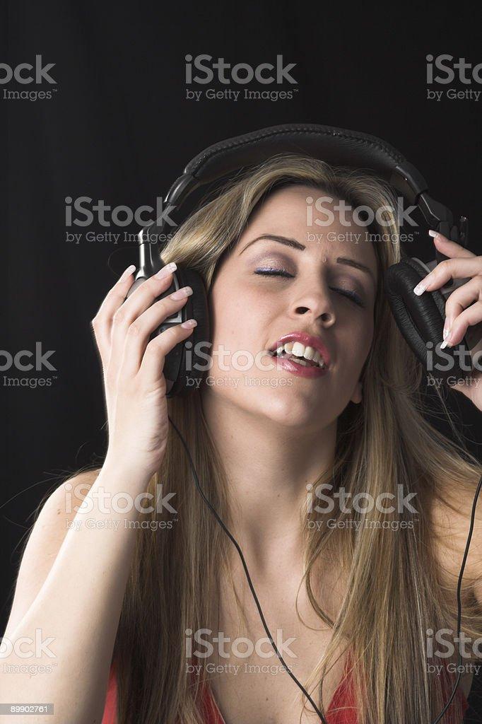 woman  listening to music stock photo