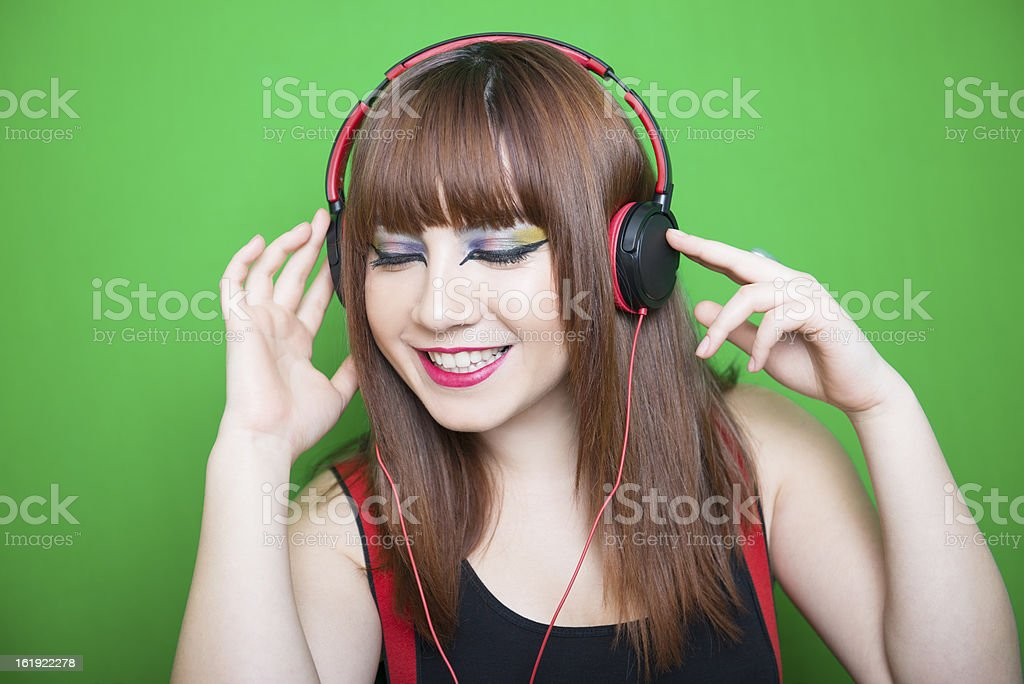 woman listening to music, the headset (XXXL) royalty-free stock photo