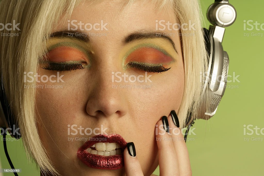 woman listening to music with headphone royalty-free stock photo