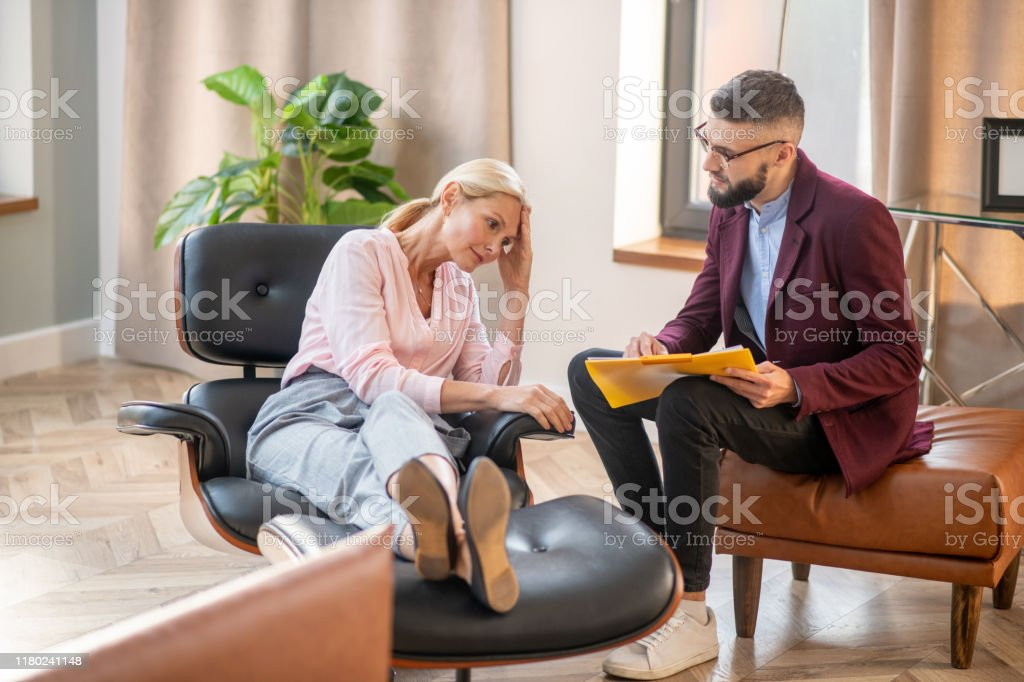 Woman Listening To Psychoanalyst And Making Conclusions Stock Photo - Download Image Now - iStock