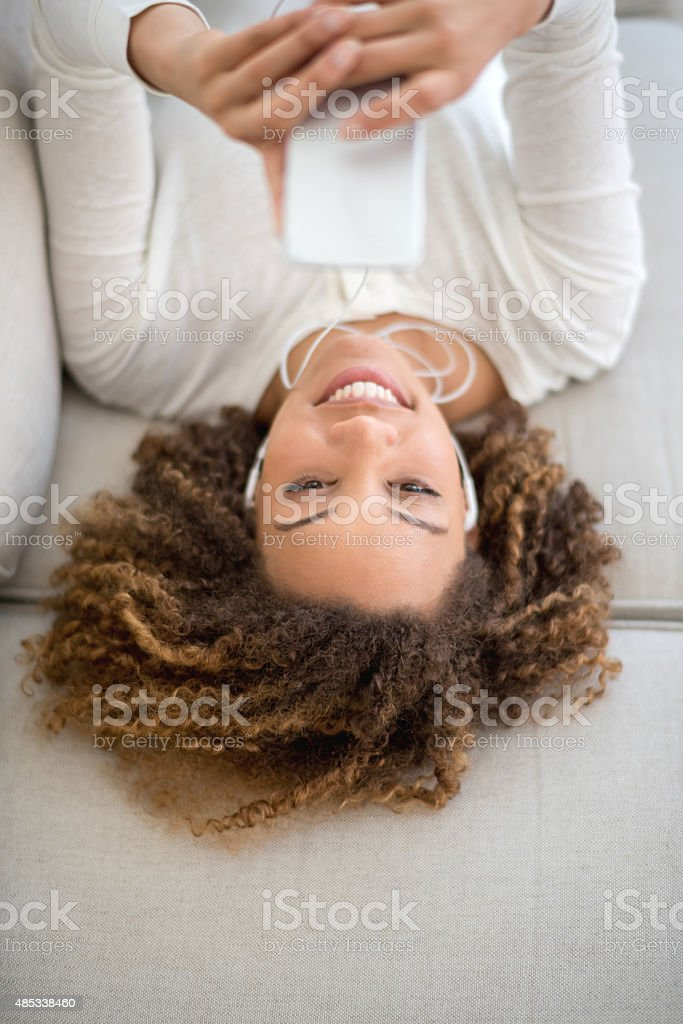 Woman listenning to music at home stock photo