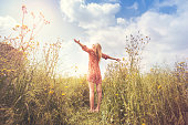 istock woman lives in harmony  and respect with nature 624546780