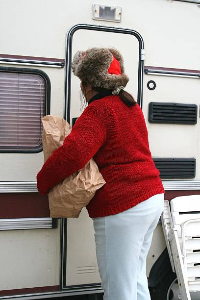 Woman living in a trailer stock photo