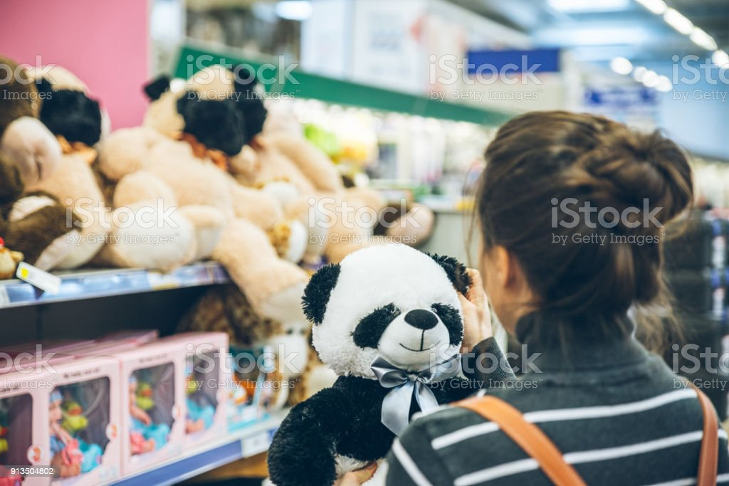 woman look for soft panda toy stock photo