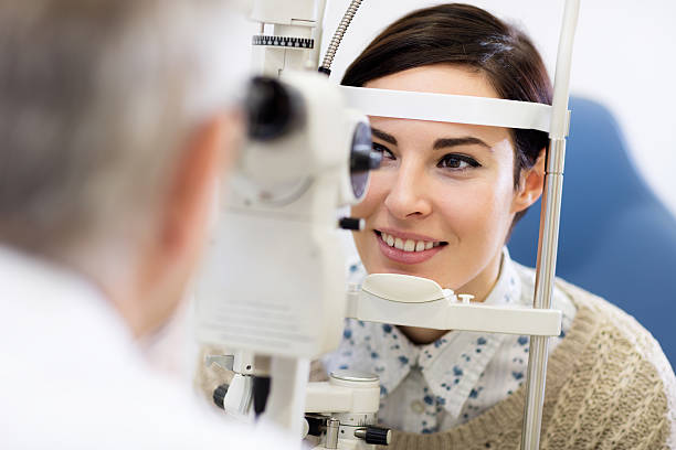 woman look in ophthalmoscope - optometrist stock pictures, royalty-free photos & images