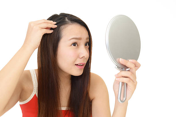 woman look unhappy with her hair - 人の髪 ストックフォトと画像