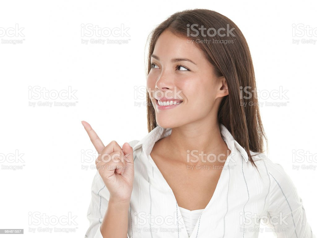Woman looking and pointing at copy space royalty-free stock photo
