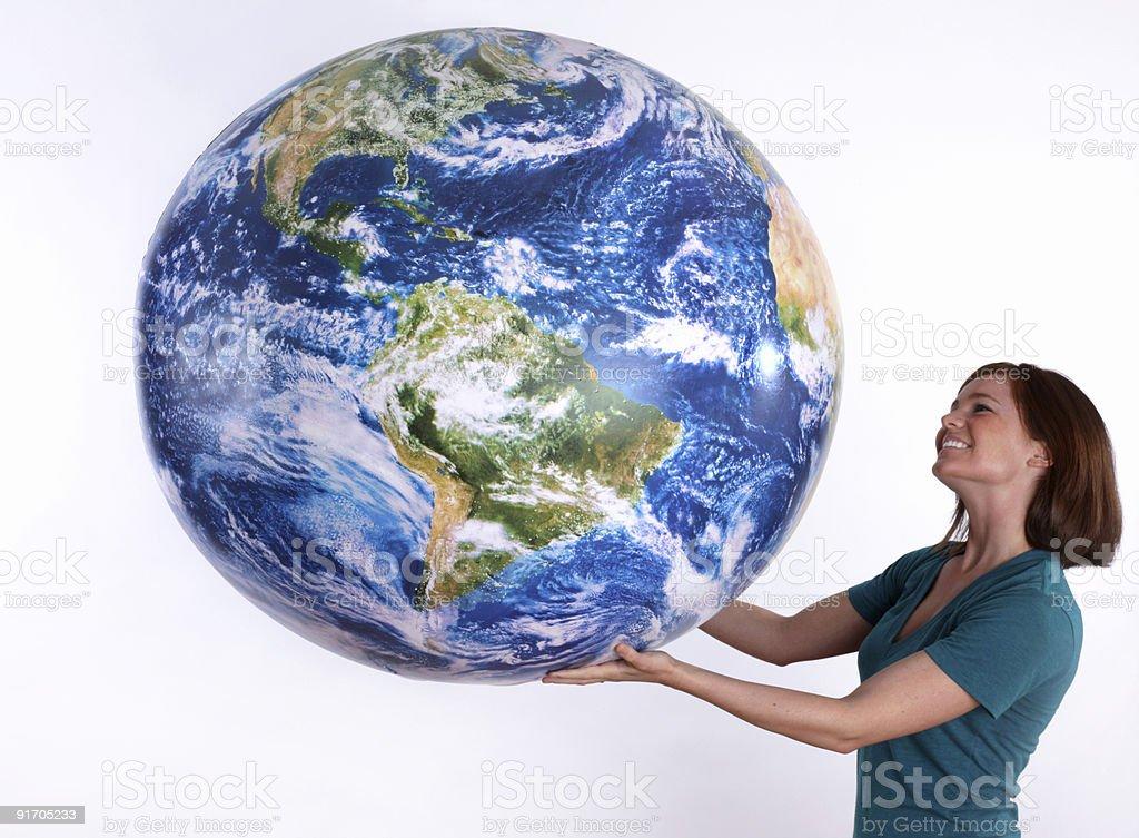 Woman looking at a large globe royalty-free stock photo