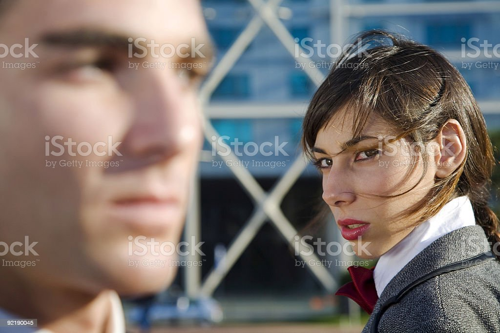 Woman looking at a man with distrust stock photo