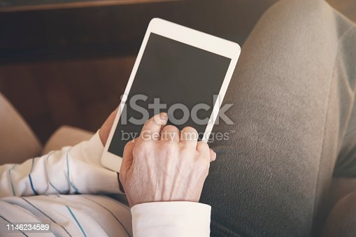 1010774222 istock photo Woman looking at a modern digital tablet 1146234589