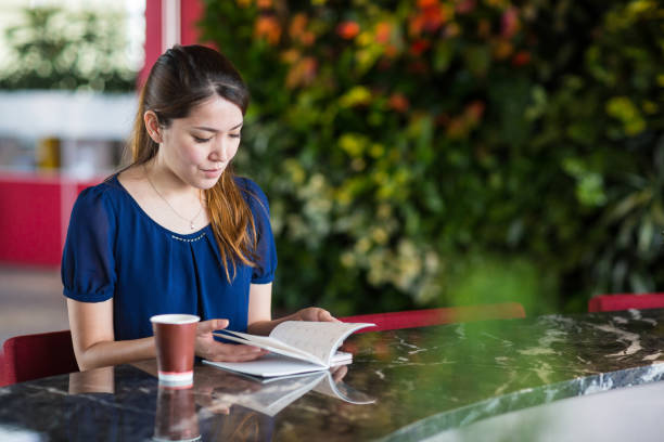 A woman looking at a note stock photo