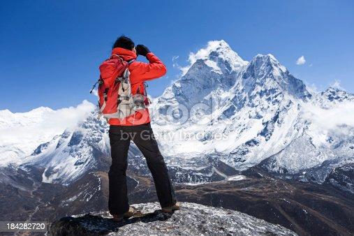 istock Woman looking at Ama Dablam, Mount Everest National Park, Nepal 184282720