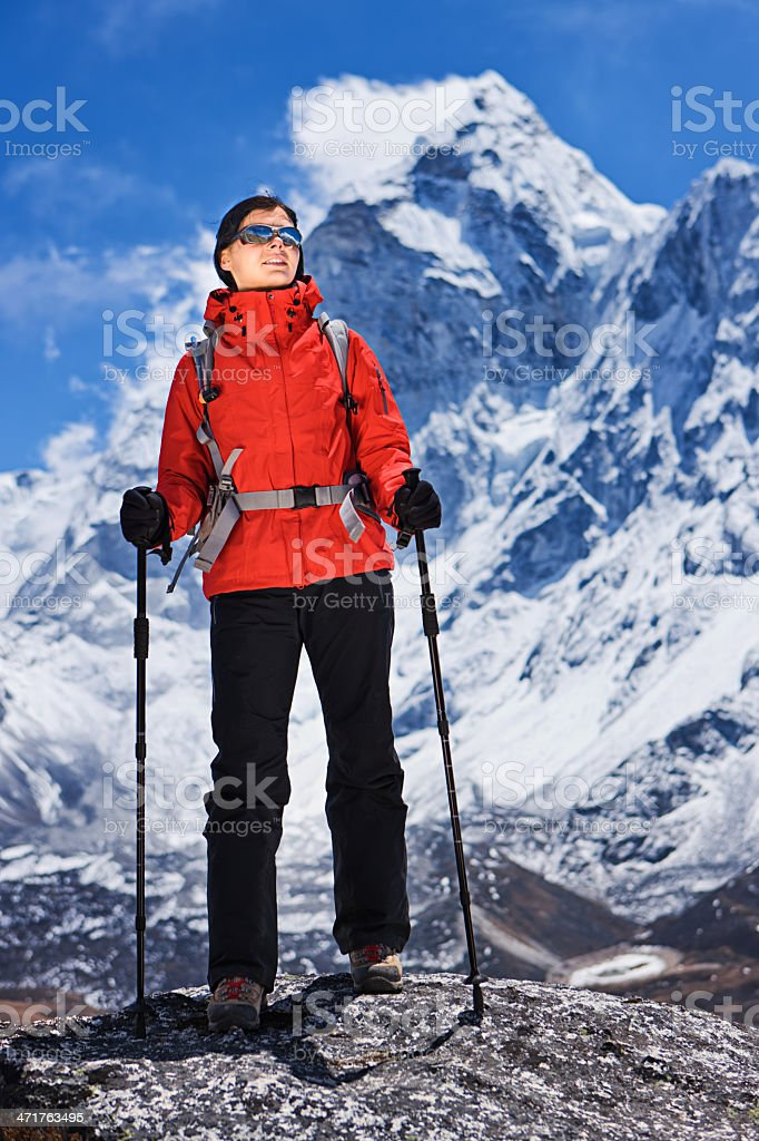 Woman looking at Ama Dablam, Mount Everest National Park, Nepal royalty-free stock photo