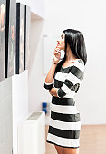 A woman looking at pictures on display in an art gallery.