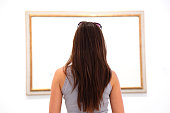 Woman looking at art painting in museum - blank canvas. Click for more: