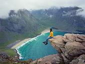 istock Woman looking at beach on Lofoten island 1204376919