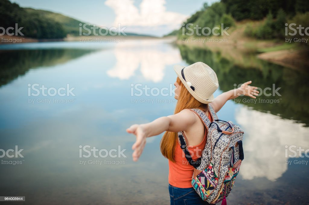Woman looking at breathtaking landscape - Royalty-free Adult Stock Photo
