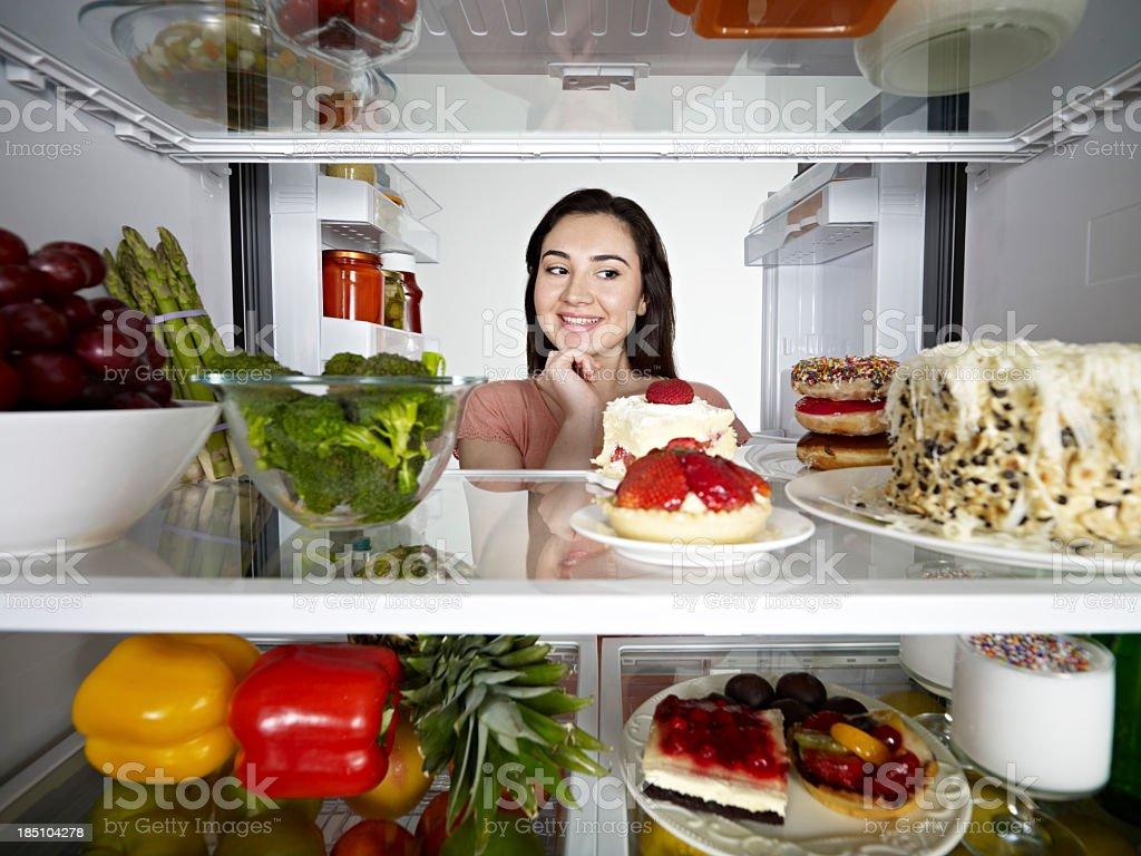 Woman Looking at Cake royalty-free stock photo